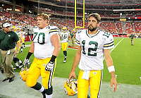 Aug. 28, 2009; Glendale, AZ, USA; Green Bay Packers quarterback (12) Aaron Rodgers and guard (70) T.J. Lang against the Arizona Cardinals during a preseason game at University of Phoenix Stadium. Mandatory Credit: Mark J. Rebilas-