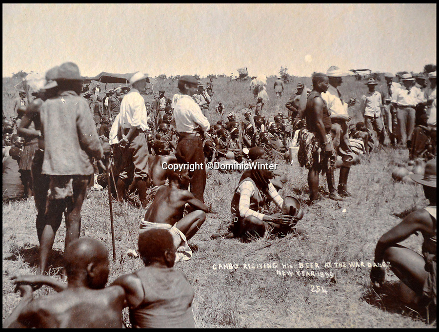 BNPS.co.uk (01202 558833)Pic: DominicWinter/BNPS<br /> <br /> 'Gambo receiving his beer at the war dance' - <br /> Rhodesia (Zimbabwe) - 1899.<br /> <br /> These fascinating photos capture life in southern Africa at the end of the 20th century at a time of great uncertainty for the region.<br /> <br /> They were taken between 1896 and 1900 and cover the period of the Second Matabele War in Rhodesia, today known as Zimbabwe.<br /> <br /> One photo shows soldiers at a lookout with ammunition around their necks poised and ready to fire.<br /> <br /> Another image is of a laager, an encampment protected by a circle of wagons or armored vehicles.<br /> <br /> There is also the remarkable sight of troops lined up on bicycles and an imposing fort in the hills.