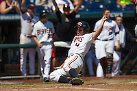 Oregon State outfielder Max Gordon (4) slides home safely against the Louisville Cardinals during Game 5 of the 2013 Men's College World Series on June 17, 2013 at TD Ameritrade Park in Omaha, Nebraska. The Beavers defeated Cardinals 11-4, eliminating Louisville from the tournament. (Andrew Woolley/Four Seam Images)