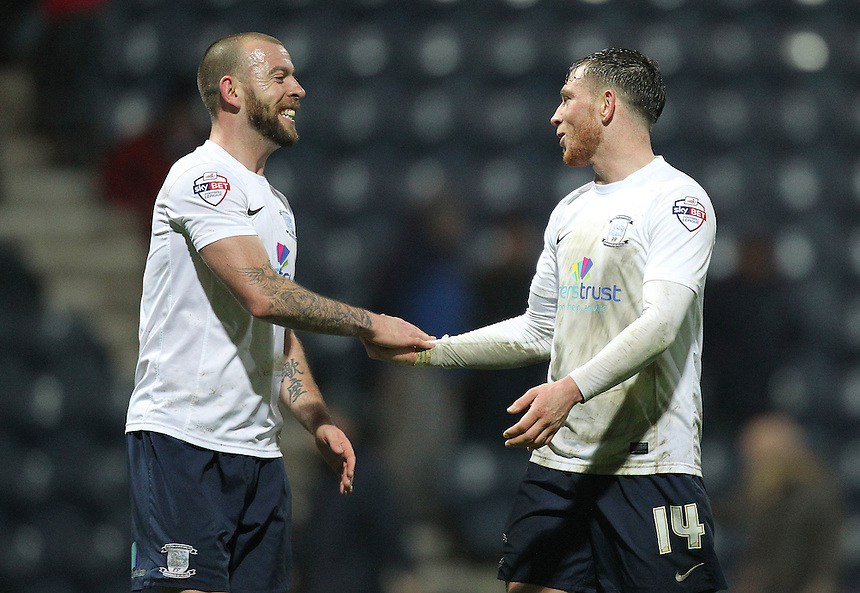 Preston North End's Joe Garner celebrates with  Keith Keane as the game ends<br />
