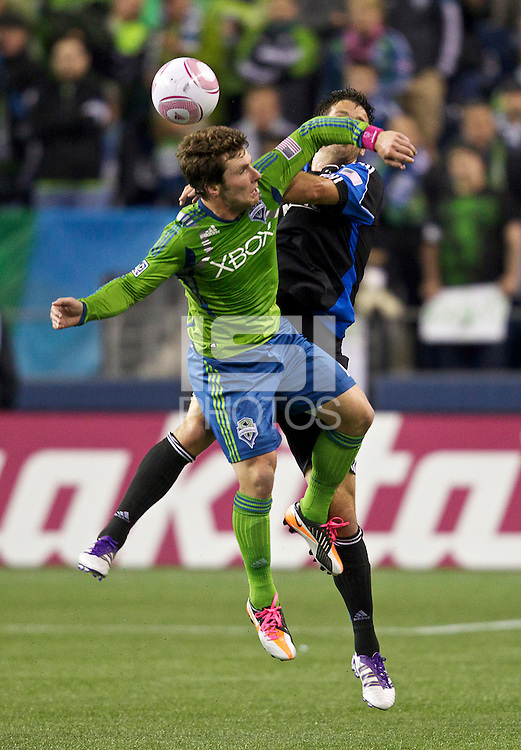 Mike Fucito, left, of the Seattle Sounders FC battle Bobby Burling of the San Jose Earthquakes during play at CenturyLink Field in Seattle Saturday October 15, 2011. The Sounders FC won the game 2-1.