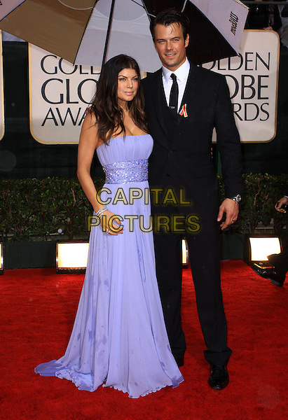STACY FERGUSON aka Fergie & JOSH DUHAMEL.67th Golden Globe Awards held Beverly Hilton, Beverly Hills, California, USA..January 17th, 2010.globes full length black eyed peas bep purple strapless maxi dress black suit married husband wife wet.CAP/ADM/KB.©Kevan Brooks/Admedia/Capital Pictures