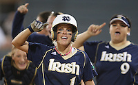 07March2008: Long Beach Invitation Softball Tournament, Notre Dame UCLA - Mayfield Park, Lakewood, CA.  Notre Dame senior Katie Laing is surrounded by teammates as she reaches home plate after hitting a home run against UCLA.  UCLA eventually came back to win with a final score of 3-2.