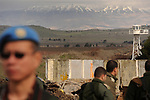 Backdropped by Mt. Hermon, Israeli soldiers, right, and a UN soldier, deployed at the Quneitra crossing, Golan Heights, on Israel-Syria border. A demilitarized UN zone separates the foe-countries Israel and Syria.<br /> <br /> Photo by Ahikam Seri