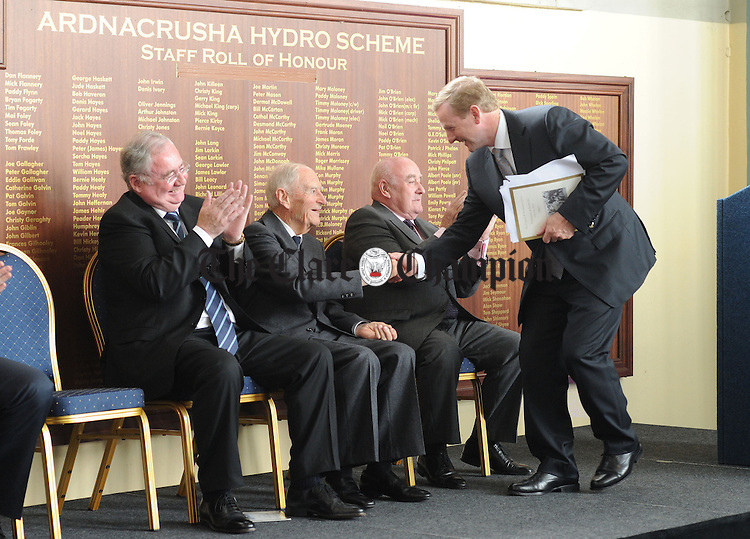 An Taoiseach Enda Kenny salutes former Taoiseach Liam Cosgrave at Ardnacrusha Power Station in the company of Pat Rabbitte, Minister for Communications, Energy and Natural Resources, and Lochlann Quinn, chairman of ESB. Photograph by Declan Monaghan
