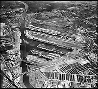 BNPS.co.uk (01202 558833)<br /> Pic: Aerofilms/HistoricEngland/BNPS<br /> <br /> Salford, Salford Docks and Manchester Ship Canal, 25 May 1947 - Now the BBC.<br /> <br /> Stunning historic aerial photos of seaside towns, naval bases, ports and shipyards which tell the story of Britain's once-great maritime tradition feature in a new book.<br /> <br /> The fascinating archive of black and white images includes views from a bygone age such as Brighton's famous West Pier, Grimsby's burgeoning fishing fleet, and London's dock yards.<br /> <br /> Iconic ships were also captured from the skies including the Cutty Sark in its final seaworthy years on the Thames, HMY Britannia in 1959, the RMS Queen Mary in 1946 and the SS Queen Elizabeth in 1969 about to make her maiden voyage.<br /> <br /> England's Maritime Heritage from the Air, by Peter Waller, is published by English Heritage and costs &pound;35.