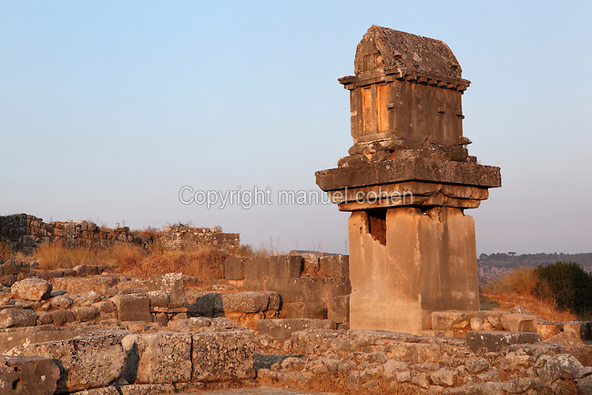The Lycian pillar tomb, thought to date from the 4th century BC, a Lycian sarcophagus on top of a short pillar tomb, Xanthos, Antalya, Turkey. This is the only tomb of its kind in Lycia. Xanthos was a centre of culture and commerce for the Lycians, and later for the Persians, Greeks and Romans, and was listed as a UNESCO World Heritage Site in 1988. Picture by Manuel Cohen