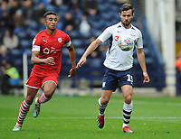 Preston North End's Joe Rafferty under pressure from Barnsley's Jacob Brown<br /> <br /> Photographer Kevin Barnes/CameraSport<br /> <br /> The EFL Sky Bet Championship - Preston North End v Barnsley - Saturday 5th October 2019 - Deepdale Stadium - Preston<br /> <br /> World Copyright © 2019 CameraSport. All rights reserved. 43 Linden Ave. Countesthorpe. Leicester. England. LE8 5PG - Tel: +44 (0) 116 277 4147 - admin@camerasport.com - www.camerasport.com