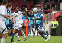 Adebayo Akinfenwa of Wycombe Wanderers controls the ball under pressure from Manny Oyeleke of Aldershot Town during the pre season friendly match between Aldershot Town and Wycombe Wanderers at the EBB Stadium, Aldershot, England on 22 July 2017. Photo by Andy Rowland.