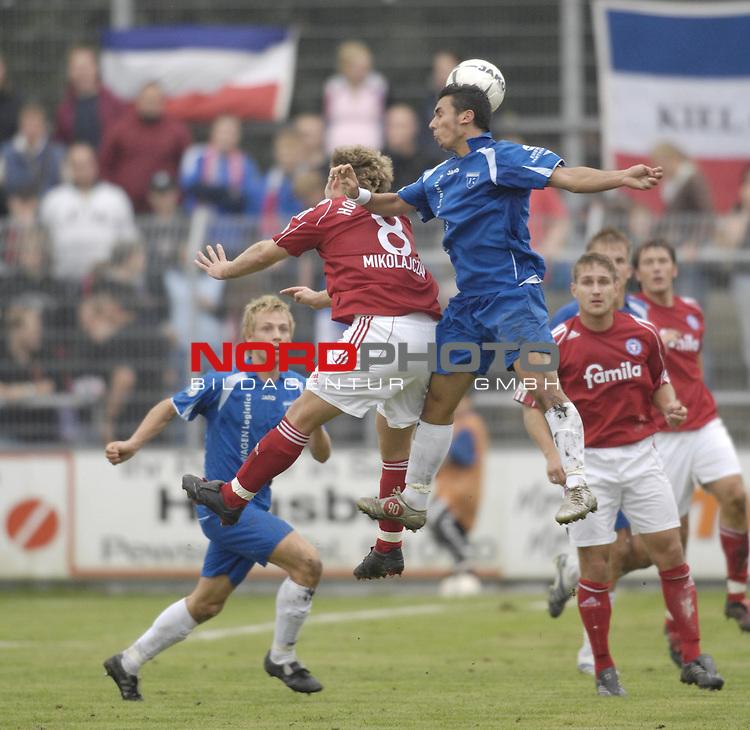 RLN 2006/2007 - 11.Spieltag Hinrunde Kickers Emden - Holstein Kiel 0:0<br /> <br /> Volkan Altin (Kickers) - Christian Mikolajczak (l.)<br /> <br /> Foto &copy; nordphoto *** Local Caption *** Foto ist honorarpflichtig! zzgl. gesetzl. MwSt.<br /> <br /> Belegexemplar erforderlich