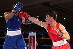 Duke Ragan, left, and Ruben Villa compete in the U.S. Olympic Boxing Trials in Reno, Nev., on Wednesday, Dec. 9, 2015. (AP Photo/Cathleen Allison)