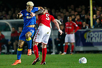 Lyle Taylor of AFC Wimbledon tangles with Patrick Bauer of Charlton Athletic during the Sky Bet League 1 match between AFC Wimbledon and Charlton Athletic at the Cherry Red Records Stadium, Kingston, England on 10 April 2018. Photo by Carlton Myrie / PRiME Media Images.