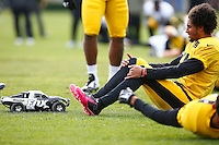Ross Cockrell #31 of the Pittsburgh Steelers stretches as an RC car races around the field at the south side practice facility on November 18, 2015 in Pittsburgh, PA.