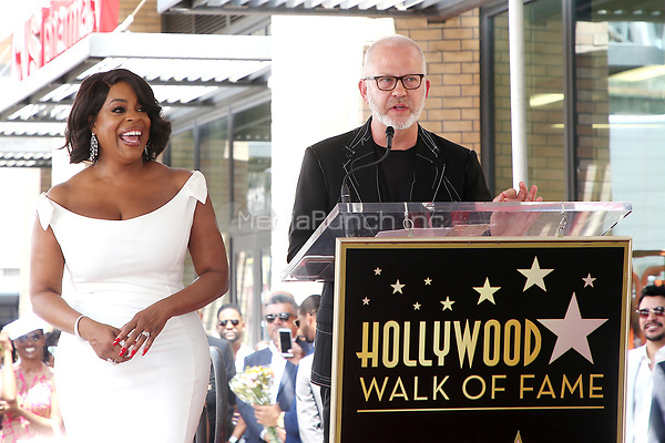 HOLLYWOOD, CA - JULY 11: Niecy Nash at the ceremony honoring Niece Nash at the Hollywood Walk Of Fame in Hollywood, California on July 11, 2018. Credit: Faye Sadou/MediaPunch