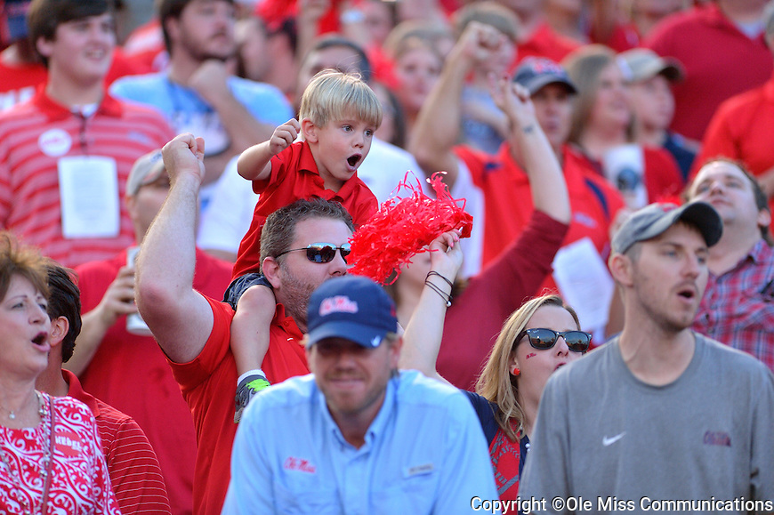 Watching the game.  Photo by Kevin Bain/Ole Miss Communications