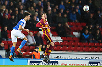 Derrick Williams of Blackburn Rovers and Charlie Wyke of Bradford City during the Sky Bet League 1 match between Blackburn Rovers and Bradford City at Ewood Park, Blackburn, England on 29 March 2018. Photo by Thomas Gadd.