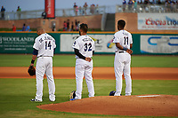 Pensacola Blue Wahoos Ivan De Jesus Jr. (14), Anthony Vizcaya (32), and Lewin Diaz (11) during the national anthem before a Southern League game against the Mobile BayBears on July 25, 2019 at Blue Wahoos Stadium in Pensacola, Florida.  Pensacola defeated Mobile 3-2 in the second game of a doubleheader.  (Mike Janes/Four Seam Images)