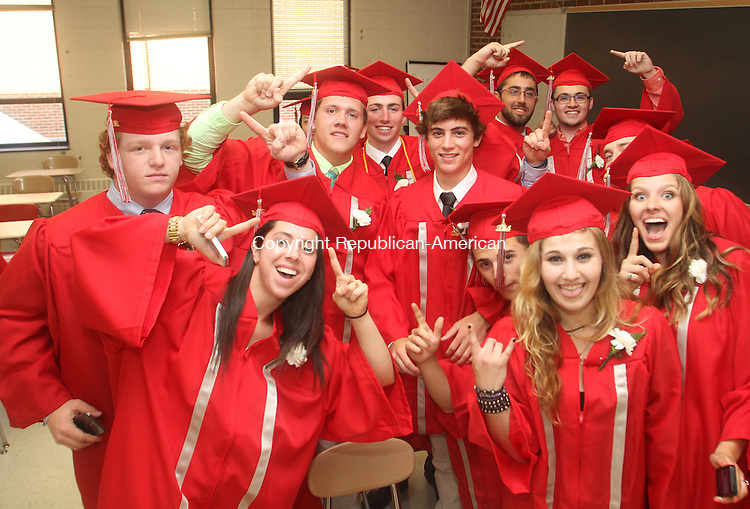 Southbury, CT-17 June 061714MK06  Members of the class of 2014 mug for the camera while waiting to beging the Pomperaug Regional High School's commencement exercises Tuesday evening in Southbury. Michael Kabelka / Republican-American
