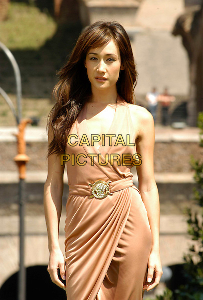 "MAGGIE Q.Photocall for ""Mission Impossible 3"" at the Colosseum, Rome, Italy..April 24th, 2006                   .Ref: CAV.half length pink wrap dress belt sleeveless.www.capitalpictures.com.sales@capitalpictures.com.© Capital Pictures."