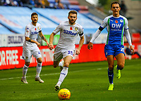 Leeds United's Stuart Dallas chases a ball under pressure from Wigan Athletic's Kal Naismith<br /> <br /> Photographer Alex Dodd/CameraSport<br /> <br /> The EFL Sky Bet Championship - Wigan Athletic v Leeds United - Sunday 4th November 2018 - DW Stadium - Wigan<br /> <br /> World Copyright &copy; 2018 CameraSport. All rights reserved. 43 Linden Ave. Countesthorpe. Leicester. England. LE8 5PG - Tel: +44 (0) 116 277 4147 - admin@camerasport.com - www.camerasport.com
