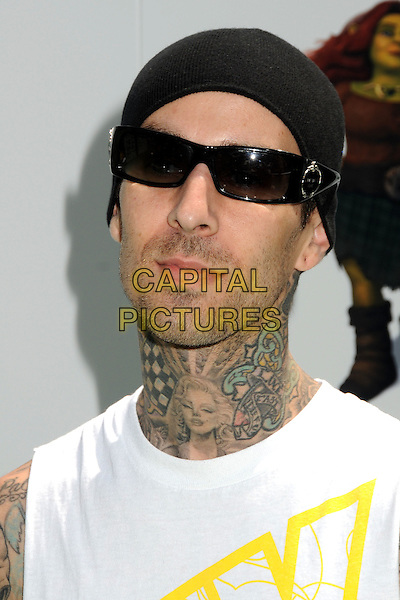 "TRAVIS BARKER .Attending the ""Shrek Forever After"" Los Angeles Film Premiere held at the Gibson Amphitheatre, Universal City, California, USA, 16th May 2010..arrivals portrait headshot tattoo facial hair beard stubble white tattoos hat sunglasses black beanie.CAP/ADM/BP.©Byron Purvis/AdMedia/Capital Pictures."
