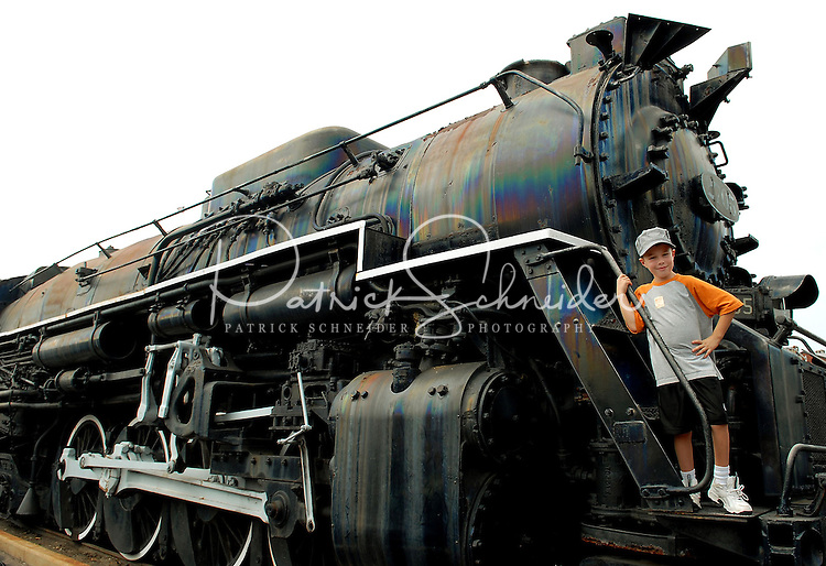 A young boy poses aboard an engine at the North Carolina Transportation Museum in Spencer, NC.
