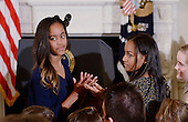 Malia Obama (L) and Sasha Obama look on during a ceremony to  presents the Medal of Freedom to Vice-President Biden in the State Dinning room of the White House, January 12, 2017 in Washington, DC.<br /> Credit: Olivier Douliery / Pool via CNP