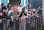 A small crowd waves at Democratic presidential candidate Hillary Clinton following her tour of Crossroads, a substance abuse facility, in Reno, Nev., on Monday, Nov. 23, 2015. Cathleen Allison/Las Vegas Review Journal
