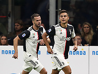 Calcio, Serie A: Inter Milano - Juventus, Giuseppe Meazza stadium, October 6 2019.<br /> Juventus' Paulo Dybala (r) celebrates after scoring with his teammate Miralem Pjanic (r) during the Italian Serie A football match between Inter and Juventus at Giuseppe Meazza (San Siro) stadium, October 6, 2019.<br /> UPDATE IMAGES PRESS/Isabella Bonotto