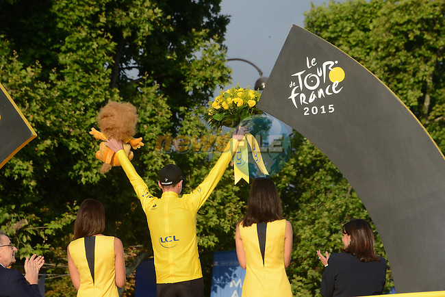 Overall Yellow Jersey winner Christopher Froome (GBR) Team Sky on the podium in Paris at the end of Stage 21 of the 2015 Tour de France running 109.5km from Sevres to Paris - Champs Elysees, France. 26th July 2015.<br /> Photo: ASO/X.Bourgois/Newsfile