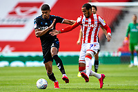 27th June 2020; Bet365 Stadium, Stoke, Staffordshire, England; English Championship Football, Stoke City versus Middlesbrough; Ashley Fletcher of Middlesbrough under pressure from Tom Ince of Stoke City