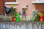 Flowers at the scene of the double murder in Langford Downs, Killorglin on Tuesday.