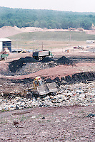 LANDFILL<br /> Waste Disposal Trucks &amp; Bulldozer<br /> Waste disposal trucks dumping refuse while the bulldozers fill the landfill.  Sullivan County, NY