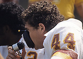 Washington Redskins running back John Riggins (44) breathes some oxygen as he rests on the bench during the game against the Kansas City Chiefs at RFK Stadium in Washington, D.C. on September 19, 1983..Credit: Arnie Sachs / CNP
