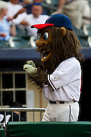 Strike, the mascot of the Northwest Arkansas Naturals signs a ball for a fan during a game against the San Antonio Missions at Arvest Ballpark on June 30, 2011 in Springdale, Arkansas. (David Welker / Four Seam Images)