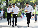"May 22, 2016, Tokyo, Japan - Japanese waiter Daisuke Sonoda (C) carries a glass of beer on a tray en route to win the ""garcon carry race"" in Tokyo on Sunday, May 22, 2016 as a  part of ""Aperitif 365"" event. 46 waiters from restaurants and cafes participated the beer carry race vying for the first prize of 300,000 yen, sponsored by French beer Kronenbourg.  (Photo by Yoshio Tsunoda/AFLO) LWX -ytd-"