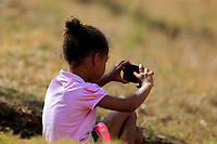 Young spectator using phone during the third round of the of the Barclays Kenya Open played at Muthaiga Golf Club, Nairobi,  23-26 March 2017 (Picture Credit / Phil Inglis) 25/03/2017<br /> Picture: Golffile | Phil Inglis<br /> <br /> <br /> All photo usage must carry mandatory copyright credit (© Golffile | Phil Inglis)