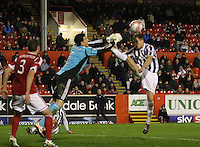 Marc McAusland goes in with a high boot on Jamie Langfield in the Aberdeen v St Mirren Scottish Communities League Cup match played at Pittodrie Stadium, Aberdeen on 30.10.12.
