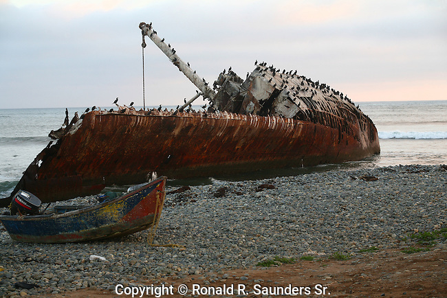 PANGA BOAT on the BEACH WITH SHIP WRECKED BOAT FLOATING OFF the MEXICAN COAST in the BACKGROUND (4)