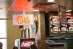 Neon sign for Halal food at burger restaurant, Seeb International Airport, Muscat, Oman