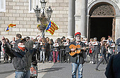 """An unidentified man waves Catalonian flags, left, as a second unidentified man plays a guitar with the words """"Freedom for Catalunya"""" written on it, right, on the street in front of the Palau de la Generalitat de Catalunya as they advocate for Catalonian independence from Spain on Tuesday, November 7, 2017. The building is a historic palace in Barcelona, Catalonia, that houses the offices of the Presidency of the Generalitat de Catalunya Barcelona. <br /> Credit: Ron Sachs / CNP"""