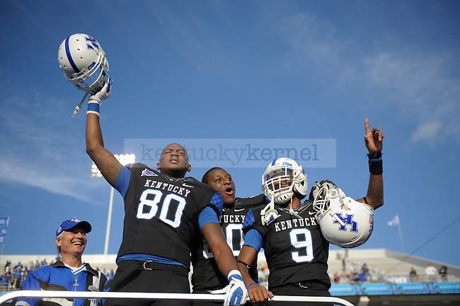 Kentucky Wildcats tight end Ronnie Shields (80), defensive end Alvin Davis (60), and wide receiver Demarco Robinson (9)(left to right) celebrate after UK won the University of Kentucky football game against Tennessee at Commonwealth Stadium in Lexington, Ky., on 11/26/11. Uk won the game 10-7. Photo by Mike Weaver | Staff