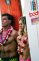 Ken Bradshaw (HAW) and Brad Gerlach (USA) at the opening ceremony of the Quiksilver Eddie Aikau Big Wave Invitational at Waimea Bay, North Shore Oahu Hawaii  circa 1990 Photo: joliphotos.com