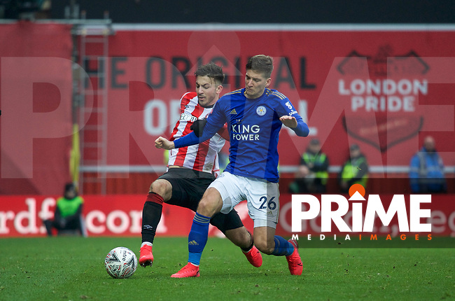 Dennis Praet of Leicester City & Halil Dervisoglu of Brentford during the FA Cup 4th round match between Brentford and Leicester City at Griffin Park, London, England on 25 January 2020. Photo by Andy Aleks.