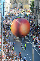 Pictured: Saturday 17 September 2016<br /> Re: Roald Dahl&rsquo;s City of the Unexpected has transformed Cardiff City Centre into a landmark celebration of Wales&rsquo; foremost storyteller, Roald Dahl, in the year which celebrates his centenary.<br /> The Giant Peach heads down Westgate Street towards Cardiff Castle.