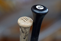 Baseball bats sit in the bat rack of the Indianapolis Indians dugout during the game against the Charlotte Knights at BB&T BallPark on August 22, 2018 in Charlotte, North Carolina.  The Indians defeated the Knights 6-4 in 11 innings.  (Brian Westerholt/Four Seam Images)