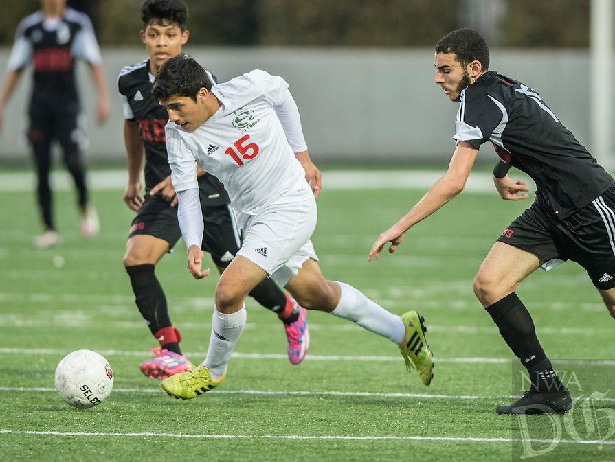 NWA Democrat-Gazette/ANTHONY REYES • @NWATONYR<br /> Erick Valverde, Springdale senior, chases down the ball against Fort Smith Northside Thursday, March 19, 2015 at Bulldog Stadium in Springdale. The Bulldogs won on penalty kicks after a 2-2 tie at the end of regulation.