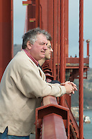 Bill and Pete Greeley gazing over the side of the Golden Gate Bridge, East Sidewalk by the South Tower.