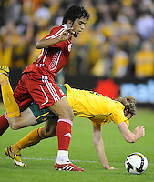 MELBOURNE, AUSTRALIA - OCTOBER 14: Joshua Kennedy from Australia fights for the ball in a AFC Asian Cup 2011 match between Australia and Oman at Etihad Stadium on October 14, 2009 in Melbourne, Australia. Photo Sydney Low www.syd-low.com