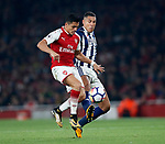 Arsenal's Alexis Sanchez tussles with West Brom's Jake Livermore during the premier league match at the Emirates Stadium, London. Picture date 25th September 2017. Picture credit should read: David Klein/Sportimage
